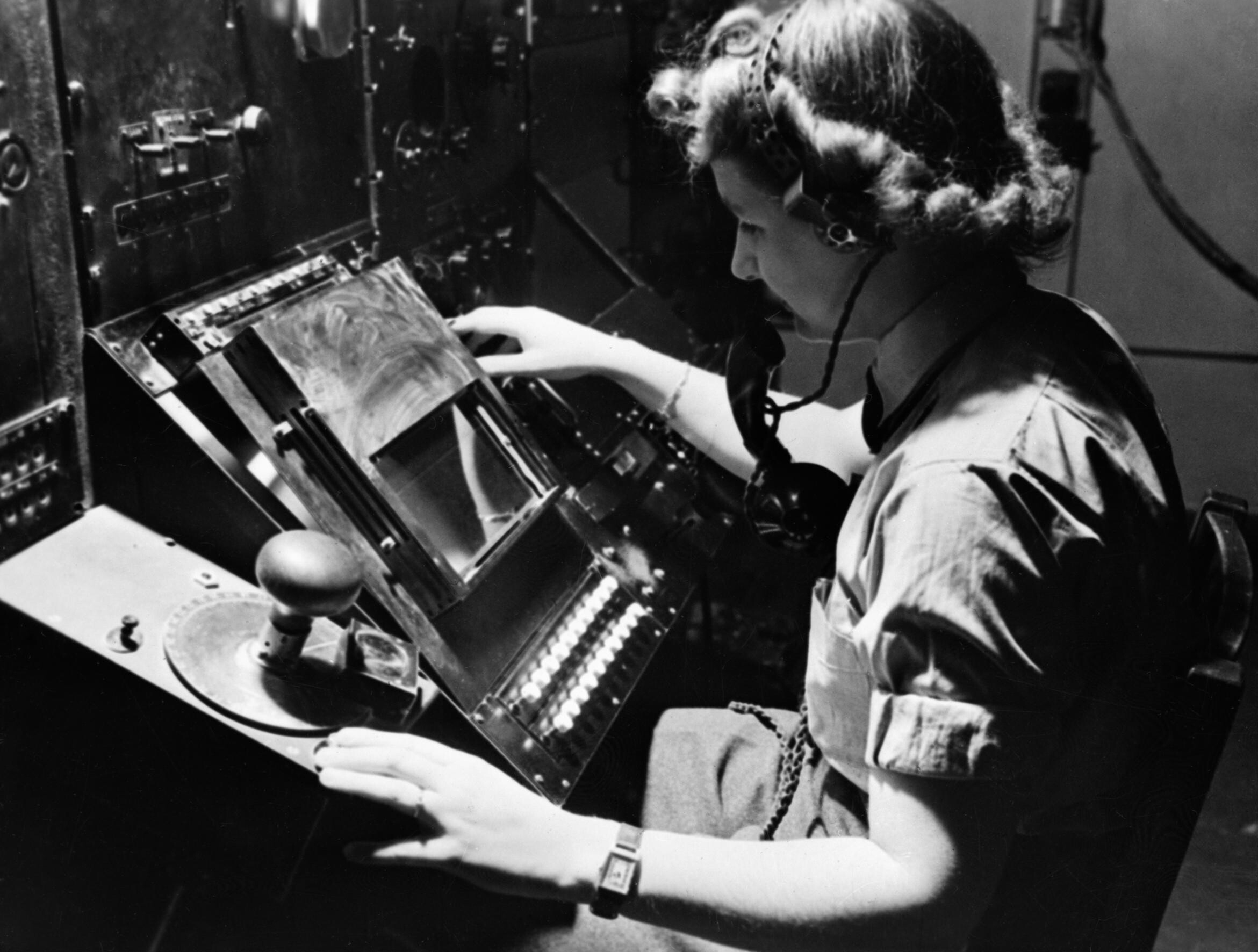 WAAF_radar_operator_Denise_Miley_plotting_aircraft_on_a_cathode_ray_tube_in_the_Receiver_Room_at_Bawdsey_Chain_Home_station_May_1945._CH15332
